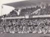 Pani učiteľka Mončeková vedie svojich zverencov na cvičenie (Spartakiáda) na štadióne v Púchove 5. júna 1965
